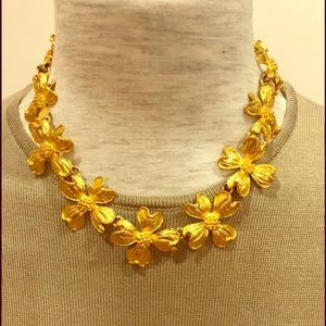 Yellow metal dogwood station necklace. NWOT
